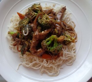 Pork, veg, black bean sauce served on a bed of noodles